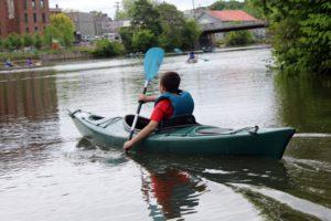 boy paddling kayak