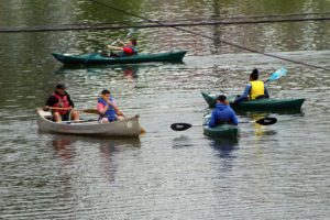 group of student paddling on the water