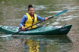 girl paddling kayak