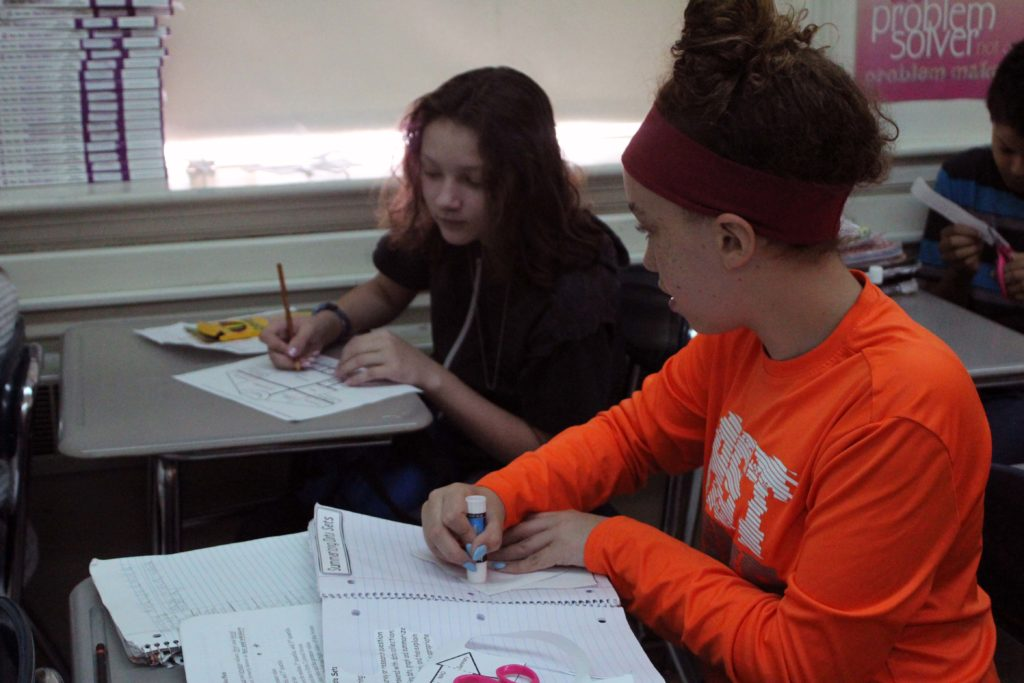 two girls doing classwork
