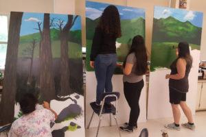 girls painting mural