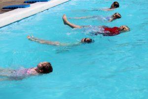 students doing backstroke