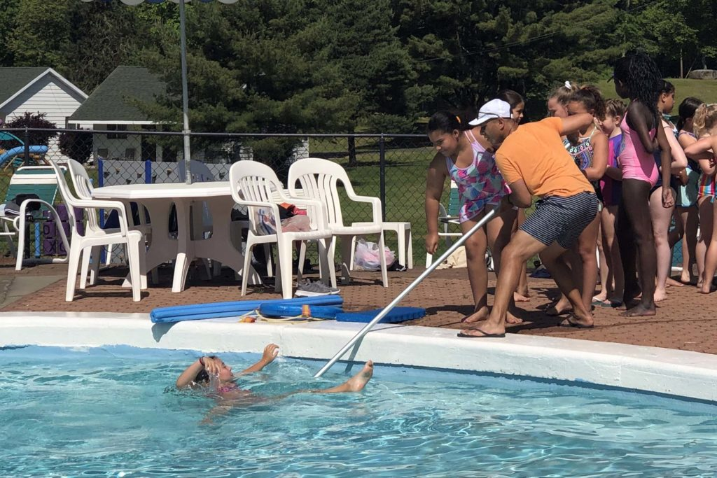 PE Teacher dempstrated how to rescue someone from a pool