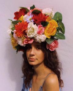 Joanna Van Slyke wearing large flower hat