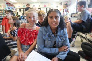 students sitting on classroom floor