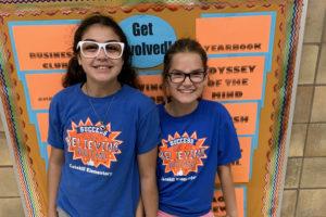 two girls wearing blue shirts