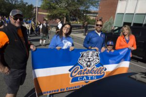 secondary administrators holding catskill banner