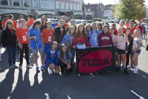 FCCLA students holding banner