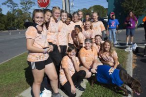girls sports team photo all wearing orange shirts