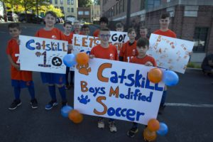 boys modified soccer team holding signs