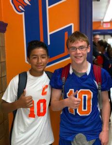 two boys wearing Catskill athletic shirts