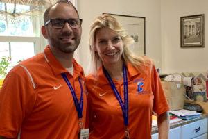 man and woman wearing orange