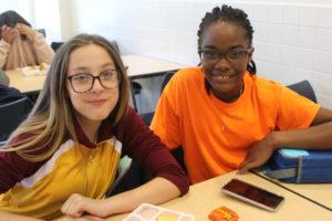 two girls wearing orange