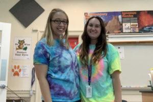 two women wearing tie-dye shirts