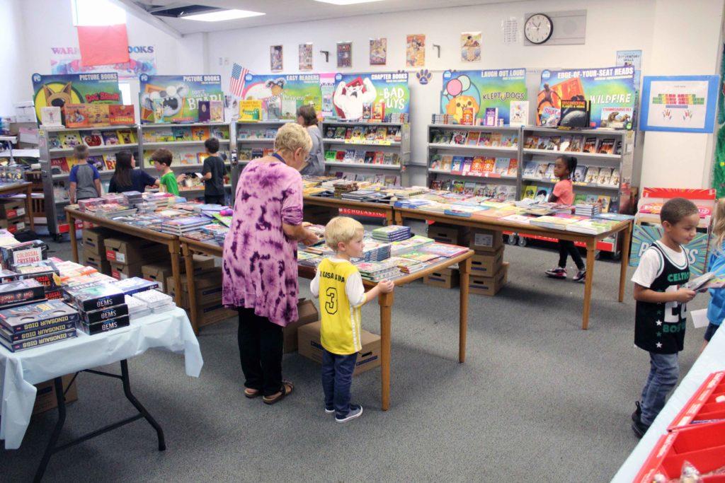 students looking at books at book fair