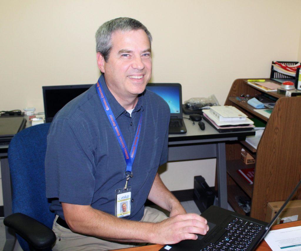 Don Marino sitting at computer