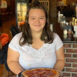 girl holding pizza