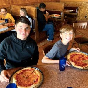 boys eating pizza