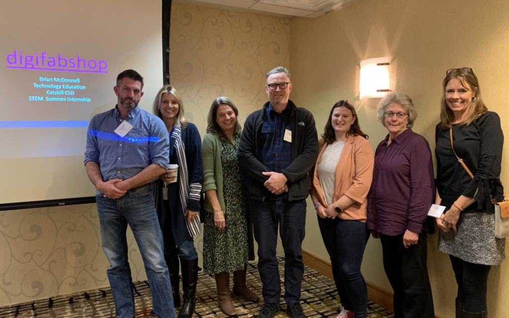 Catskill staff pose for group photo at conference