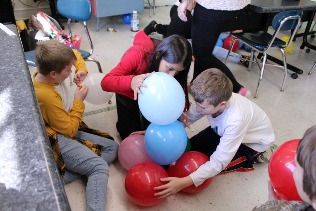 students building balloon tower