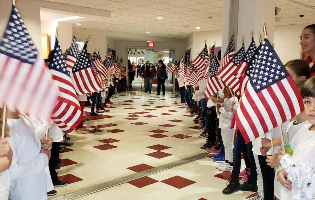 Students holdinf flags in hallway