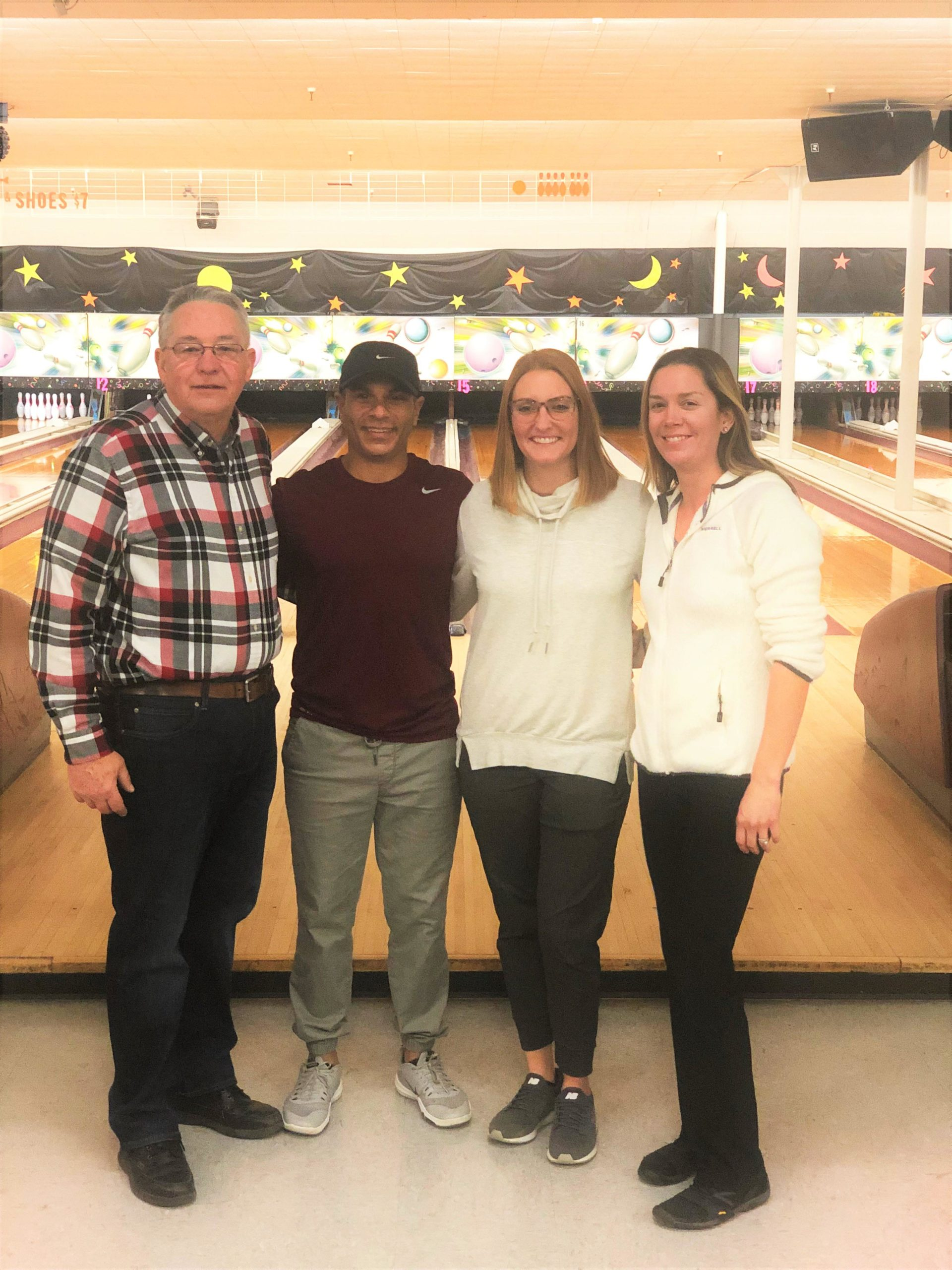Varsity bowling coach Lenny Reyngoudt and PE staff Brian Smith, Brooke Conklin, and Cait Davis