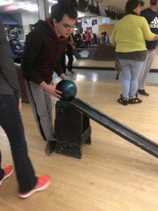 boy bowling using training ramp