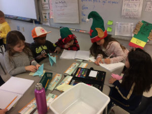 students working on crafts around table