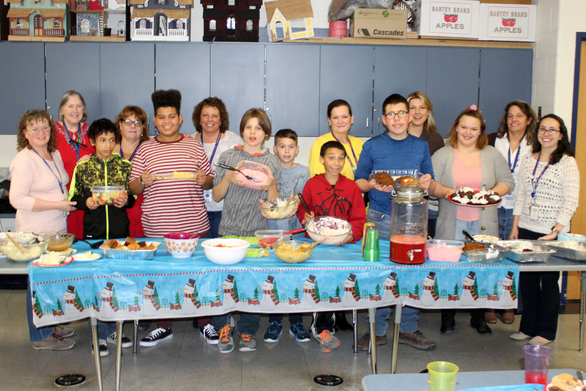 Life Skills Class poses with food they made