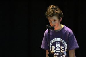 Samuel Kubicek spelling on stage
