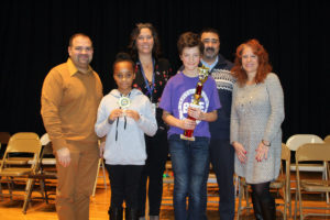 Pictured with Sam and Iana are CES Spelling Bee Committee teachers Matthew Luvera, Alexandra Standish and Heather Schindler, and Principal John Rivers.