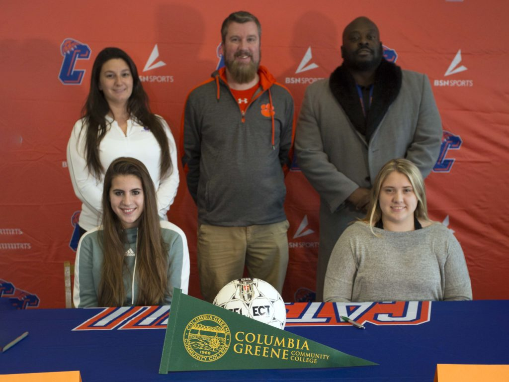 Laura Christman and Kelsey Lackie with Catskill coach Coach Caitlyn Dodig, athletic director Eric Joyce, and superintdent Dr. Ronel Cook