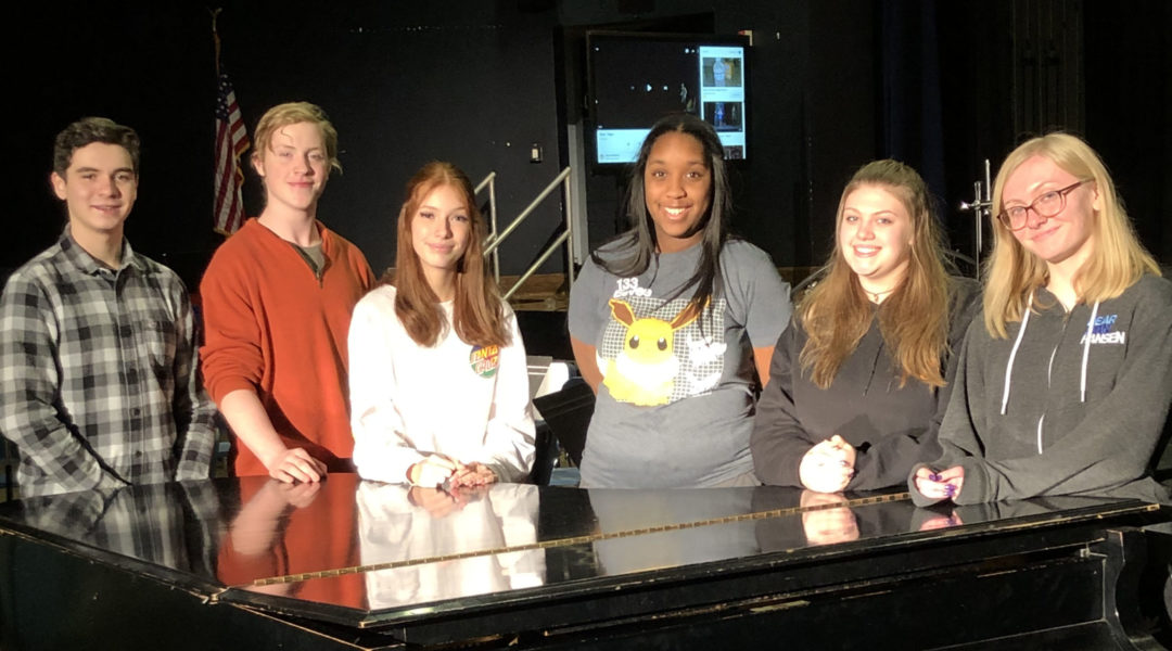 Matthew Caro, Elisha Clause, Isabella Truncale, Ava Higgins, Grace McCulloch, and Deandra Catterson. standing at piano