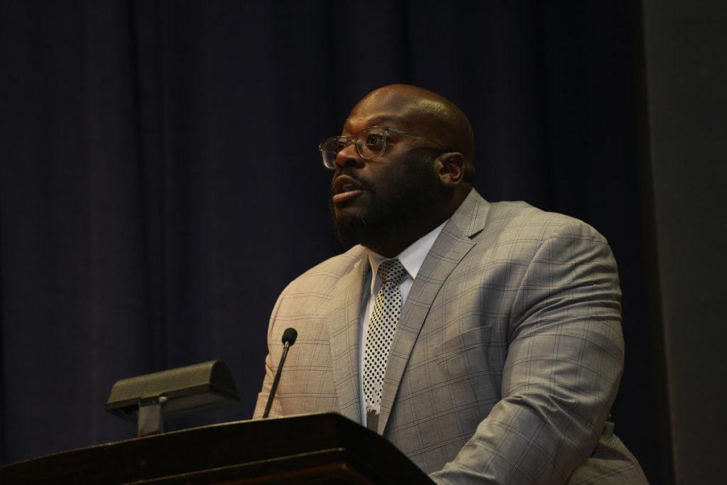 Dr. Cook speaking at podium