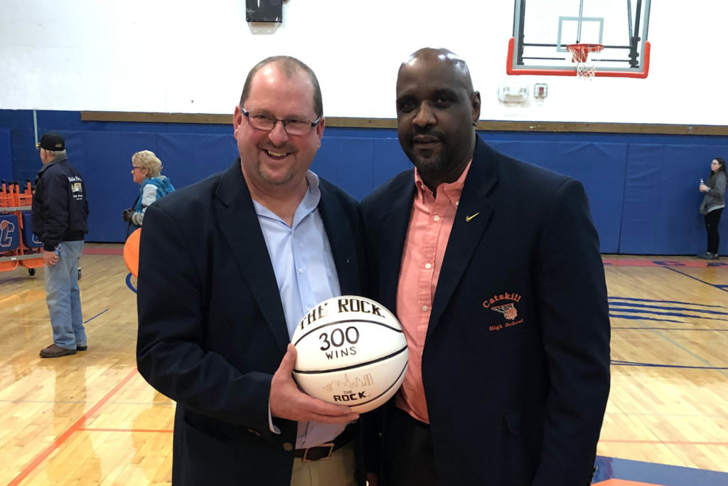 Coach Lampman holding 300 basketball with assistant coach Andy Jones