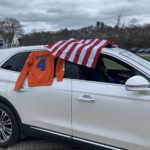 car decorated with American flag and catskill jersey