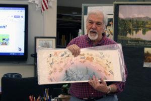 Hudson Talbot holds up painting