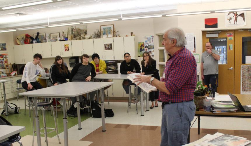 Hudson Talbot showing art work to students