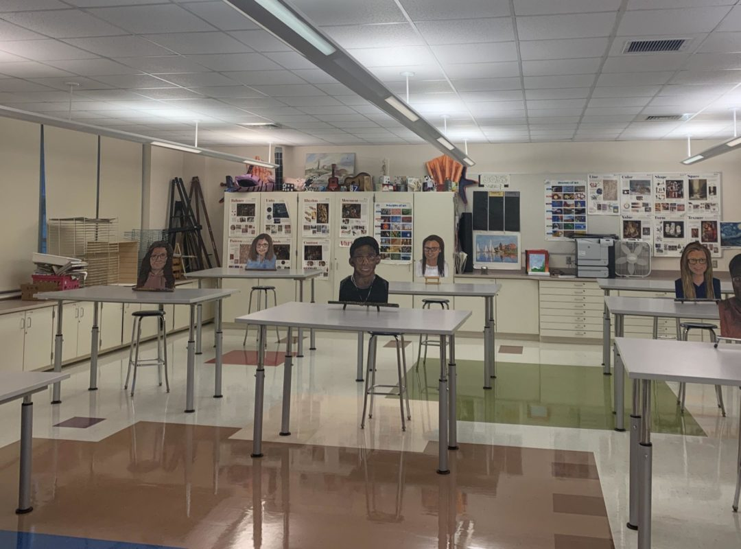 cut outs of students at desks