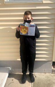 boy holding certificate