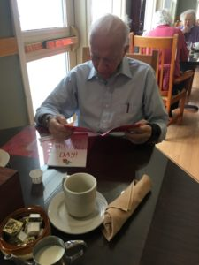 man reading card