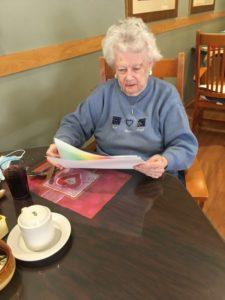 woman reading card
