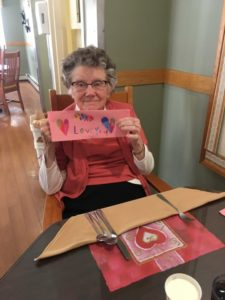woman holding up Valentine Card