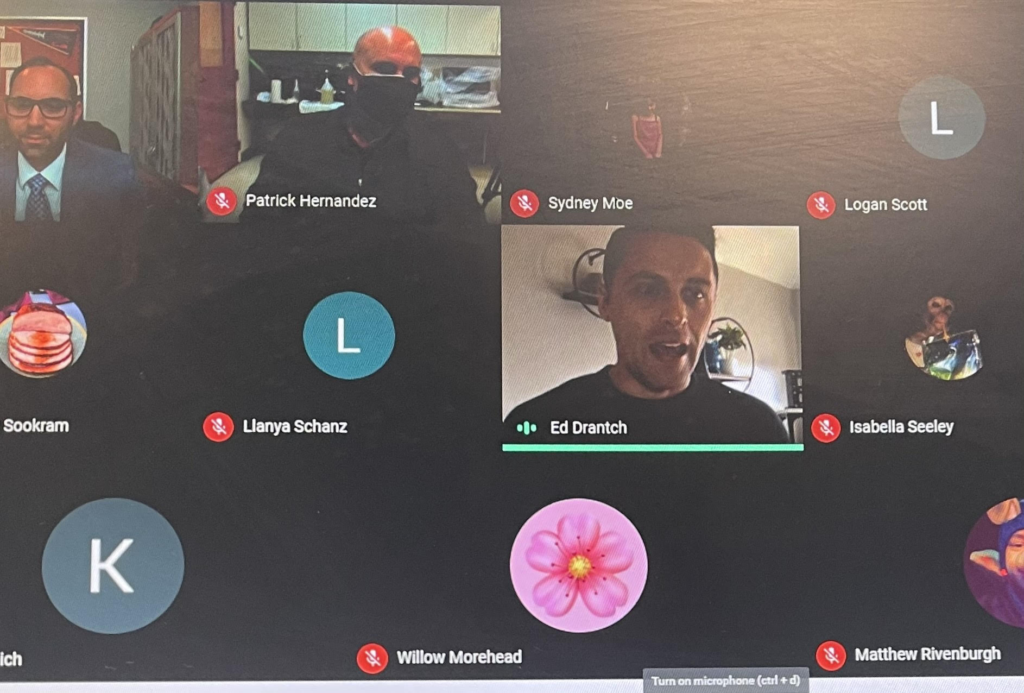screen shot of video conference showing three men