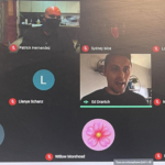 screenshot of video conference showing three men