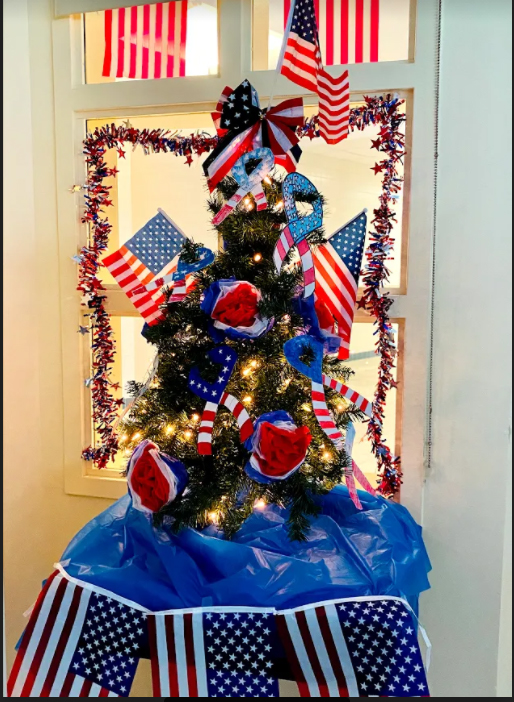 tree decorated with American flags