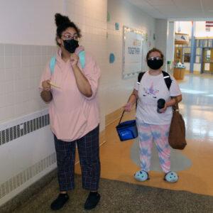 two girls wearing pjs