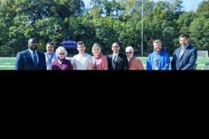 Administrators and Board Members cut ribbon on track and field