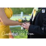 Boy in tux putting corsage on wrist of girl in dress